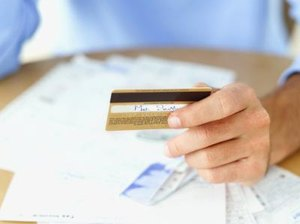 Does Being a Secondary Person on a Credit Card Lower My Credit Score?