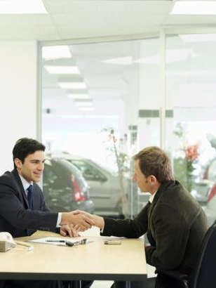 An attorney-in-fact may transfer title to a vehicle for someone else.