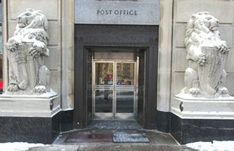 Postal workers work out of a post office.