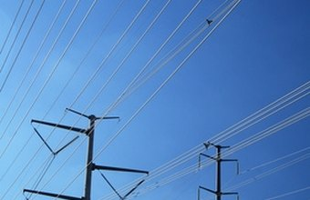 Power plants generate electricity for transmission over power lines.