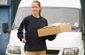 Courier with package in front of company van