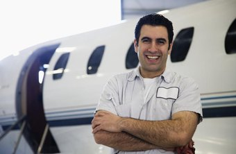 an aviation technician stands in front of a plane