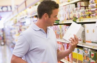 Man looking at product packaging in grocery store