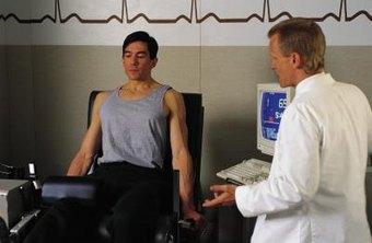 Neurodiagnostic technologist preparing to run diagnostic test on patient.