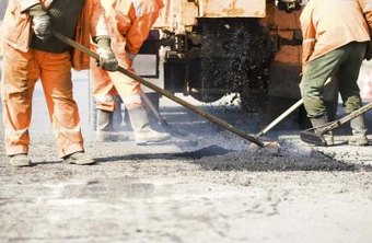 A group of workmen re-paving a road