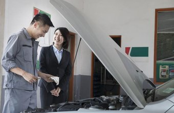 A mechanic is chatting with a customer.