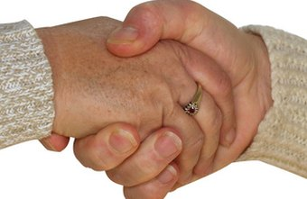 A good handshake is proper business etiquette.
