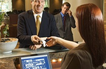 Front desk staff check in travelers.