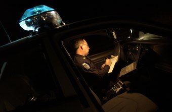 A police officer prepares for fixed surveillance.