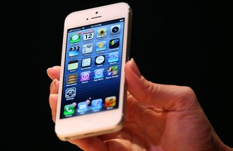 The iPhone can be tethered wirelessly or through USB.