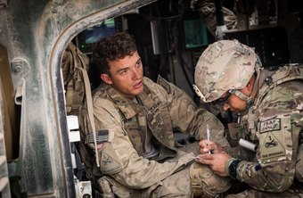 Army health care specialists treat soldiers wounded in combat.