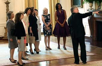 An interpreter, at right, translates first lady Michelle Obama's tour of the White House for foreign first ladies.