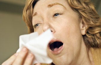 Offer your coughing co-worker a lozenge to soothe her cough.