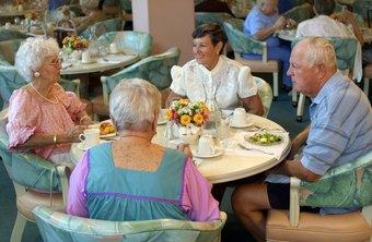 Dietary aides in assisted-living facilities help serve meals to residents.