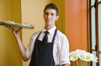 A successful waiter helps customers enjoy a meal.