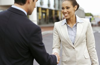 Add a smile to your verbal business introduction to convey friendliness.