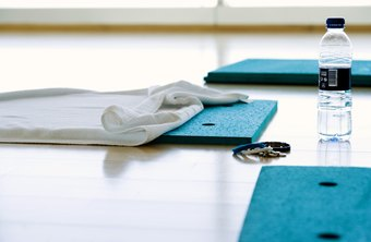 Padded mats provide support during Pilates floor exercises.