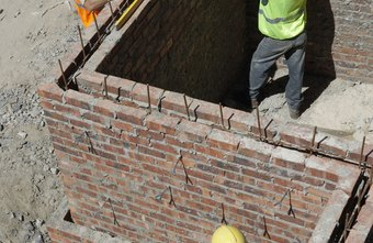 Bricklayers can surround structures using brick.