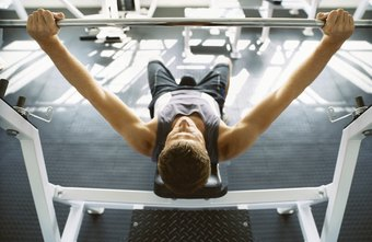 Bench press is one chest exercise that may be included in a Crossfit workout.
