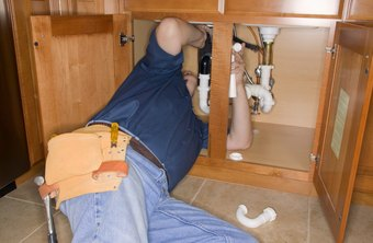 Plumbers learn to work in cramped spaces.