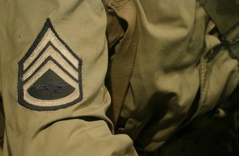 A staff sergeant wears a badge that signifies his rank.