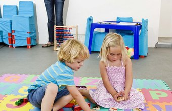 Daycare workers make sure kids play well together.