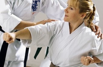 Karate instructors teach various punching and kicking techniques to students.