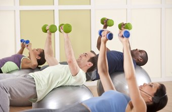 Fitness trainers teach groups new exercises.