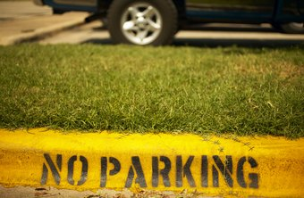 Some curbs are painted to identify no-parking areas and tow-away zones.