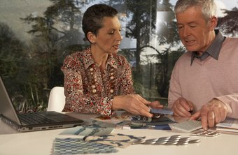 An interior designer helps clients to select fabrics.