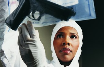 Crime lab analysts study evidence such as weapons.