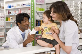A pharmaceutical technician helps a pharmacist process prescription orders.