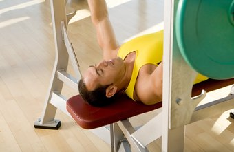 Use a standard bench to perform reverse-grip bench presses.