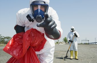 Environmental remediation technicians wear special protective clothing to clean up toxic waste.