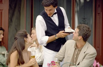 Waiters serve food and beverages to customers.