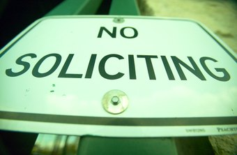 A business will often post its no soliciting policy.