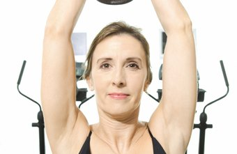 An overhead dumbbell extension tightens underarm flab.