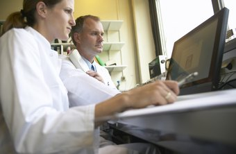Medical lab technicians use computers to analyze results.