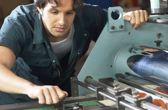 An assembly line worker uses a learned skill to perform his job.