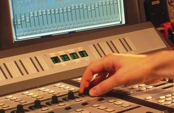 Recording technicians adjust sound quality through mixers.