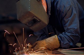 Welders wear masks, helmets and other safety gear.