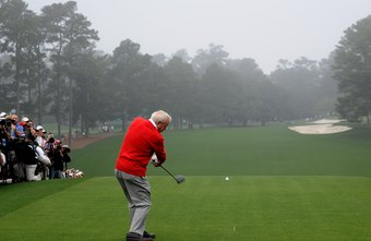 Arnold Palmer swings the club with a closed face on the downswing.
