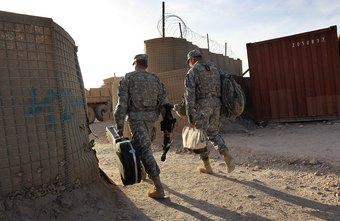 Army chaplain assistant Sgt. Oscar Santiago escorts Chaplain Capt. Kevin Burton on an Afghan mission.