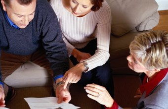 Mortgage account executives might visit clients at home to complete a loan application.
