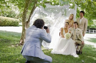 Studio photographers take pictures of special events including weddings and graduations.