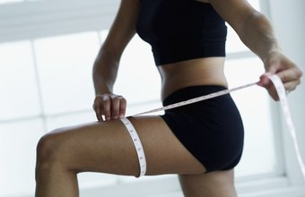 Slim your thighs with a combination of regular exercise and low-calorie diet.