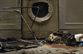 Fire restoration technicians salvage appliances, furniture, carpet and other personal items after a house fire.