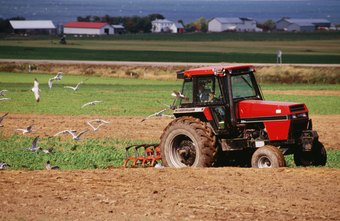 Farmers use different types of plows to prepare fields for planting.
