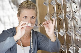 Paraoptometric technicians help customers choose frames.