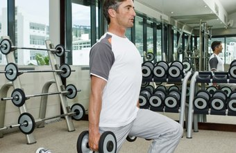 Dumbbell lunges recruit several large muscles in the legs, core and shoulders.